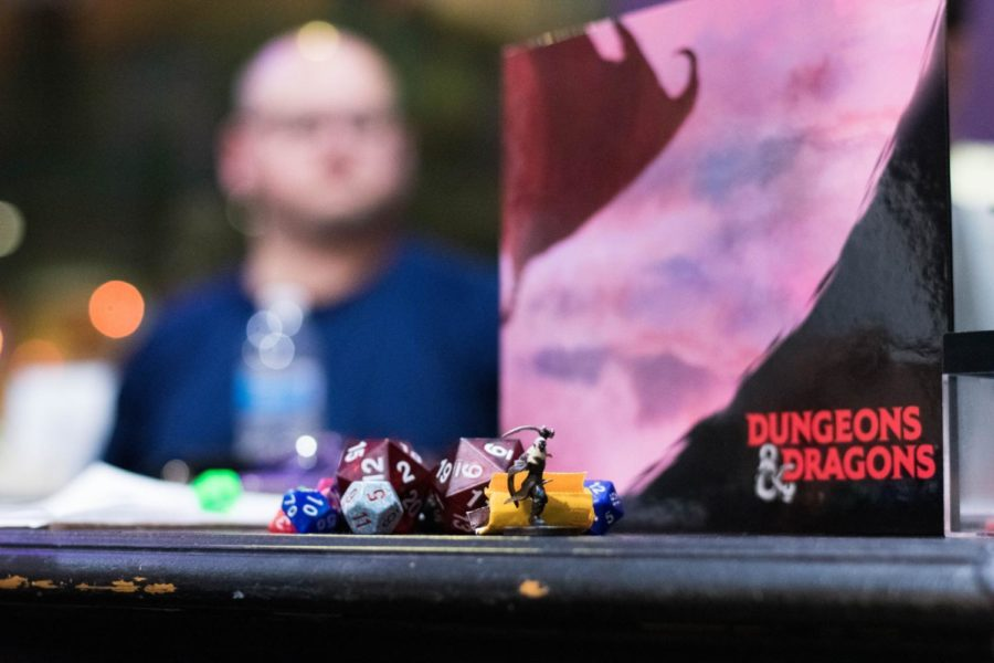 Guests+play+Dungeons+and+Dragons+at+d4+Gaming+Cafe.+Owners+Mark+and+Tracy+Meyer+brought+the+cafe+to+Oak+Street+in+late+March+2018.+Photo+credit%3A+Michael+Bauer