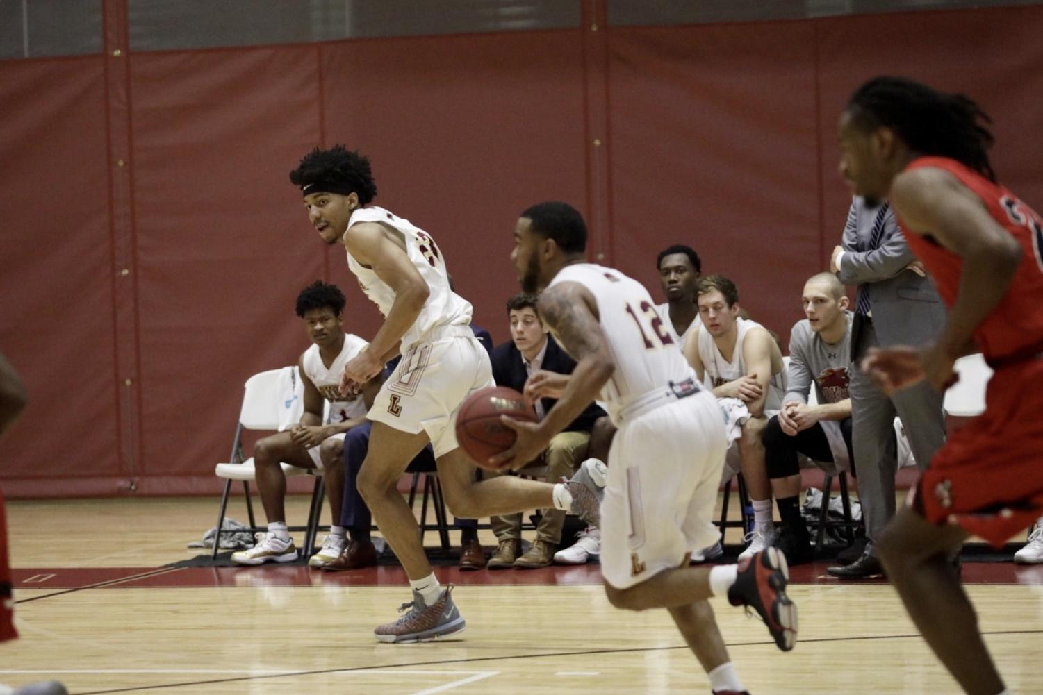 Mass communication senior Eric Brown (12) drives the offensive play in transition. Photo credit: Andres Fuentes