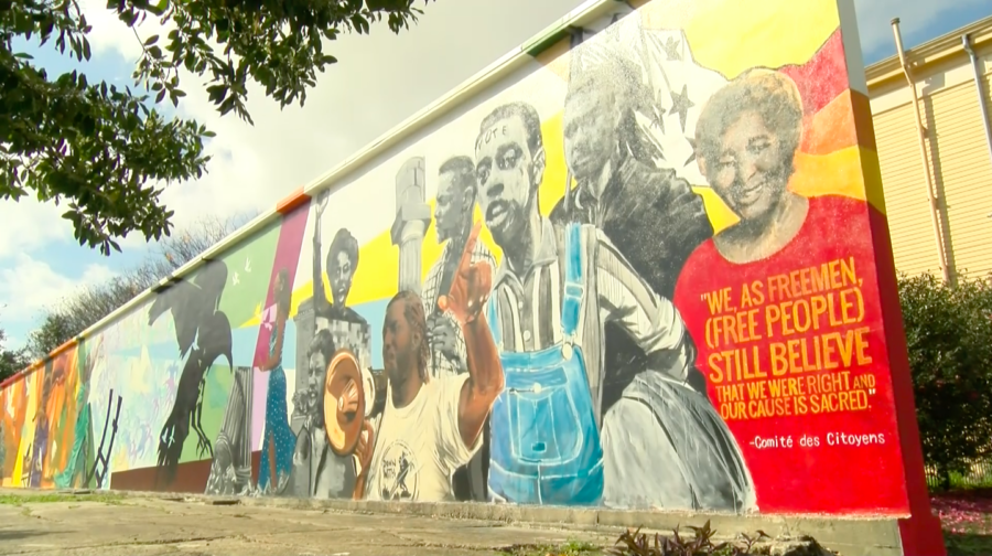 A+mural+commemorating+U.S.+civil+rights+struggles+sits+on+display+near+the+intersection+of+Royal+Street+and+Homer+Plessy+Way.+The+mural%2C+painted+by+artist+Ayo+Scott%2C+was+commissioned+by+the+New+Orleans+Center+for+Creative+Arts+and+presented+to+the+public+last+year.+Photo+credit%3A+India+Yarborough