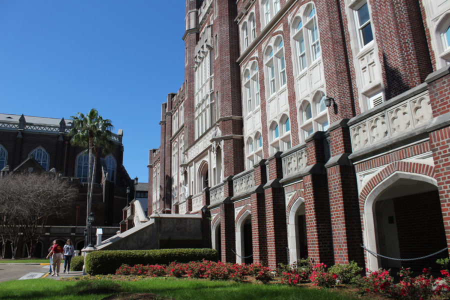 Students+walk+in+front+of+Marquette+Hall.+Loyola+is+evaluating+all+buildings+on+campus.+Photo+credit%3A+Cristian+Orellana