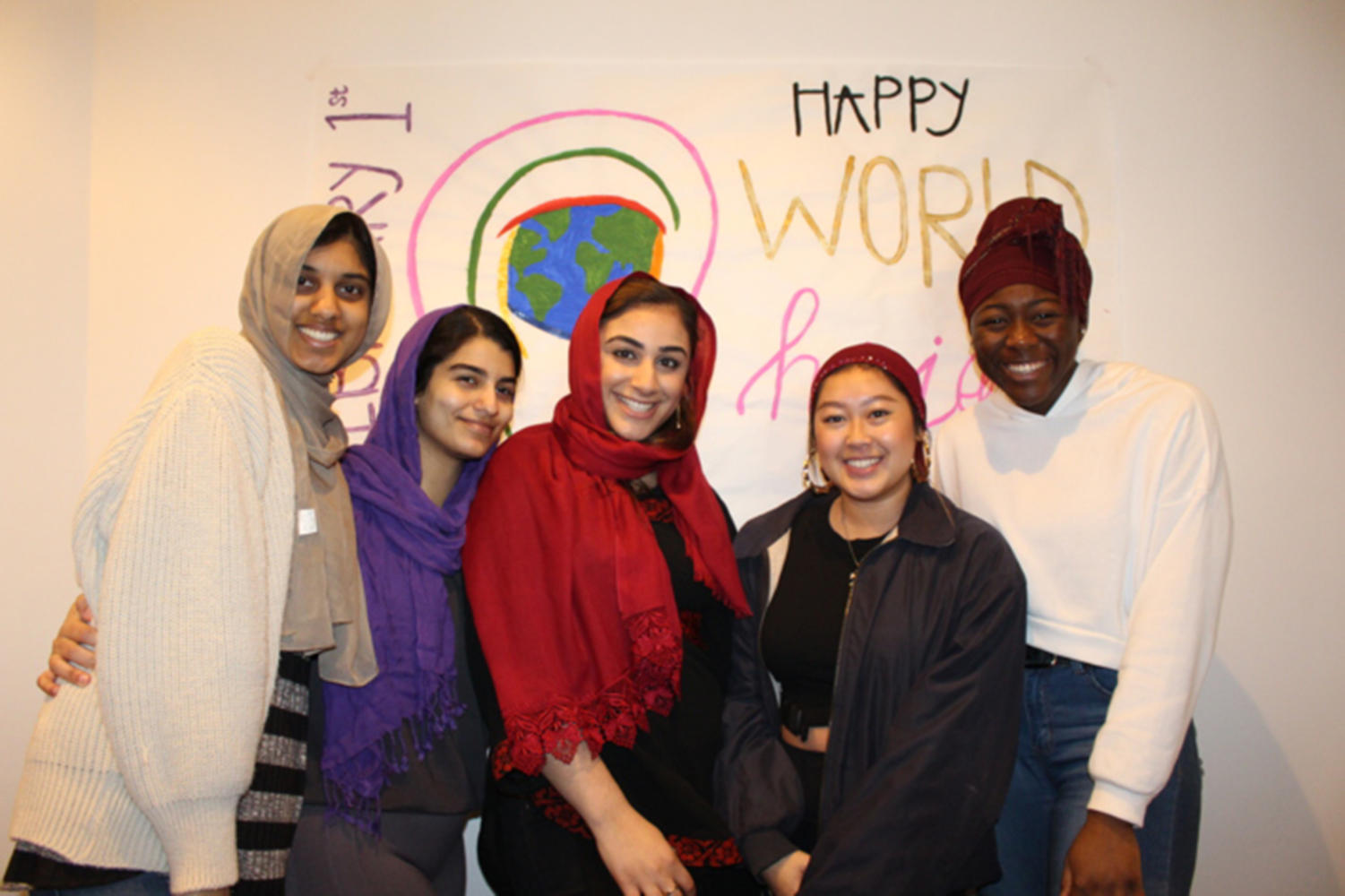 A group of Loyola students tries on hijabs during the Muslim Students Association's celebration of World Hijab day on Feb. 1.  The organization hosted the event in order to combat stereotypes about people who wear hijabs. Photo credit: Ruba Esmail
