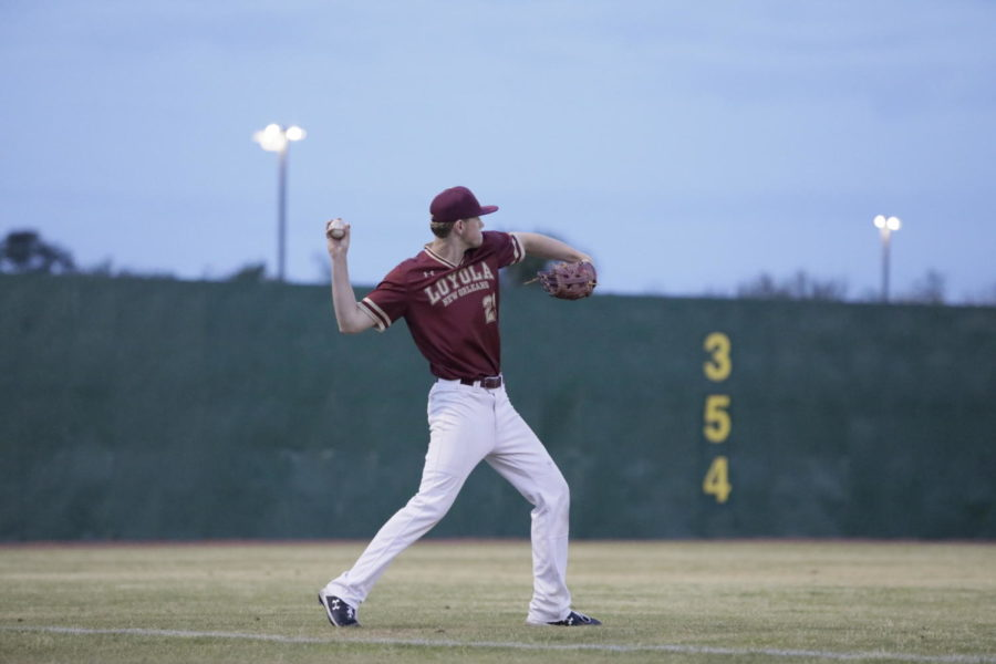 A+Loyola+baseball+player+warms+up+before+a+home+game+at+Segnette+Field.+Loyola+is+now+on+a+six-game+losing+streak.+Photo+credit%3A+Andres+Fuentes