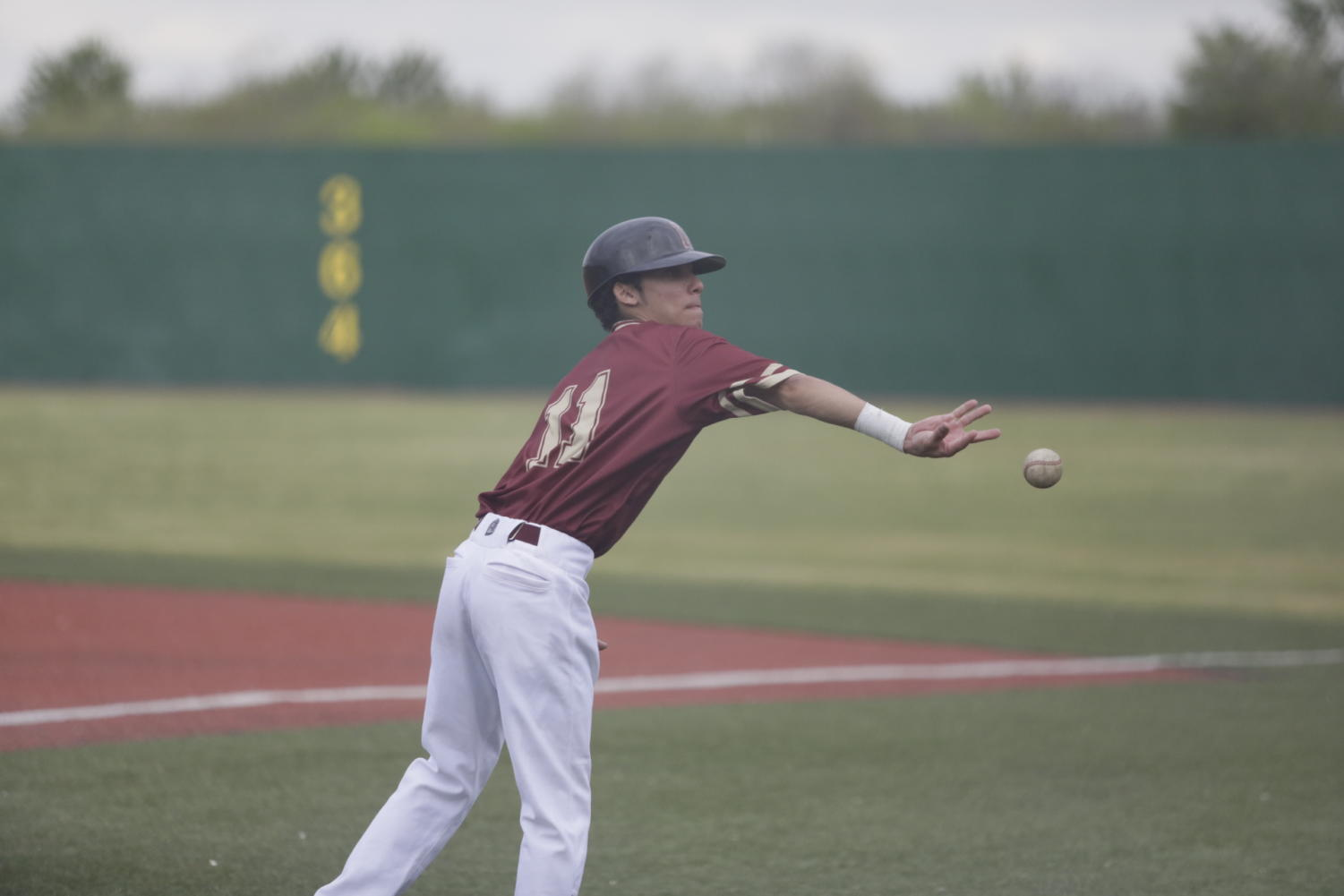 Biophysics freshman Derek Oliveras (11) throws a ball at Segnette Field. After their home series versus Martin Methodist, Loyola's baseball team remains winless in conference play. Photo credit: Andres Fuentes