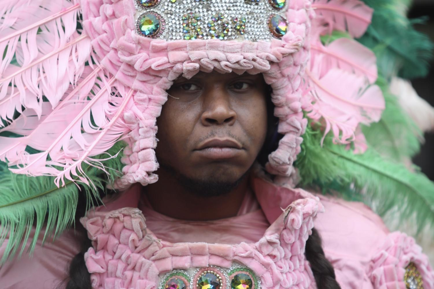 A member of the Wild Tchoupitoulas wears his traditional outfit for 3rd Friday in the Peace Quad on Feb. 15, 2019. Mardi Gras Indians have a tradition rooted in the holiday.