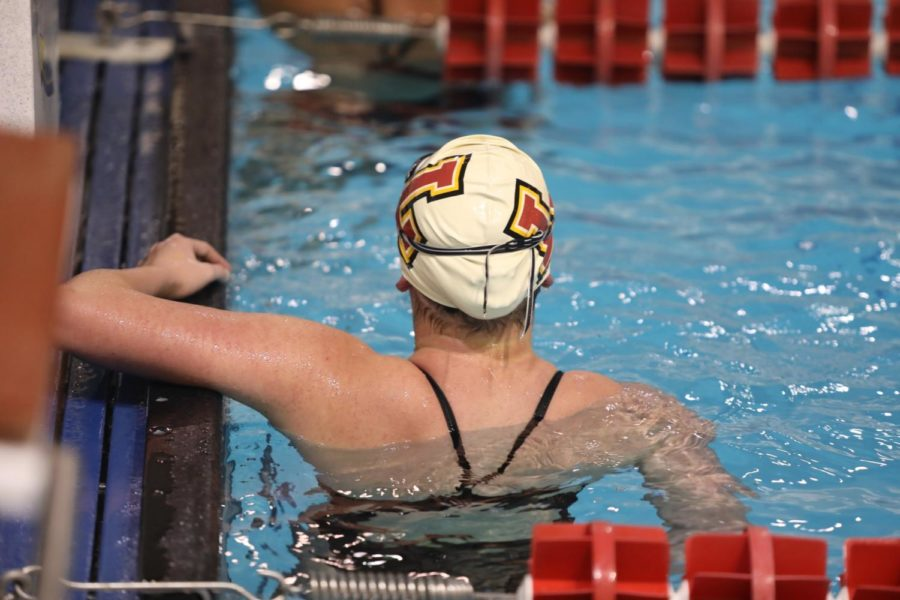 A+Loyola+women%27s+swimmer+looks+at+her+total+time+after+her+relay+race+at+a+home+meet+on+Jan.+9%2C+2019.+Loyola%27s+swim+teams+had+top-10+finishes+for+the+second+year+in+a+row.+Photo+credit%3A+Andres+Fuentes