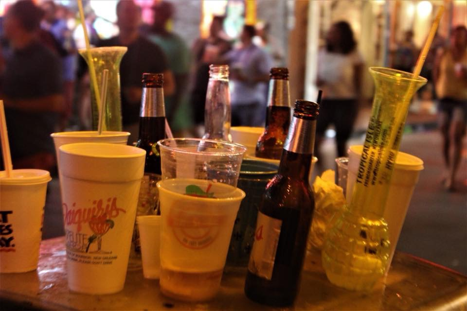 Bottles and cans line a table on Bourbon Street. The street is a popular destination for students and tourists. Photo credit: Andres Fuentes