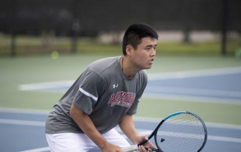 Men's tennis wins big at home