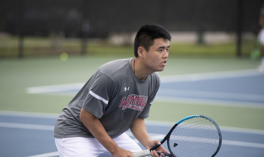 Business+sophomore+Tiger+Cheung+would+be+in+the+lead+court+in+singles+competition%2C+winning+8-0+over+his+opponent.+Cheung+now+has+a+3-0+record+this+year+when+he+plays+in+the+lead+court.+Photo+credit%3A+Loyola+New+Orleans+Athletics