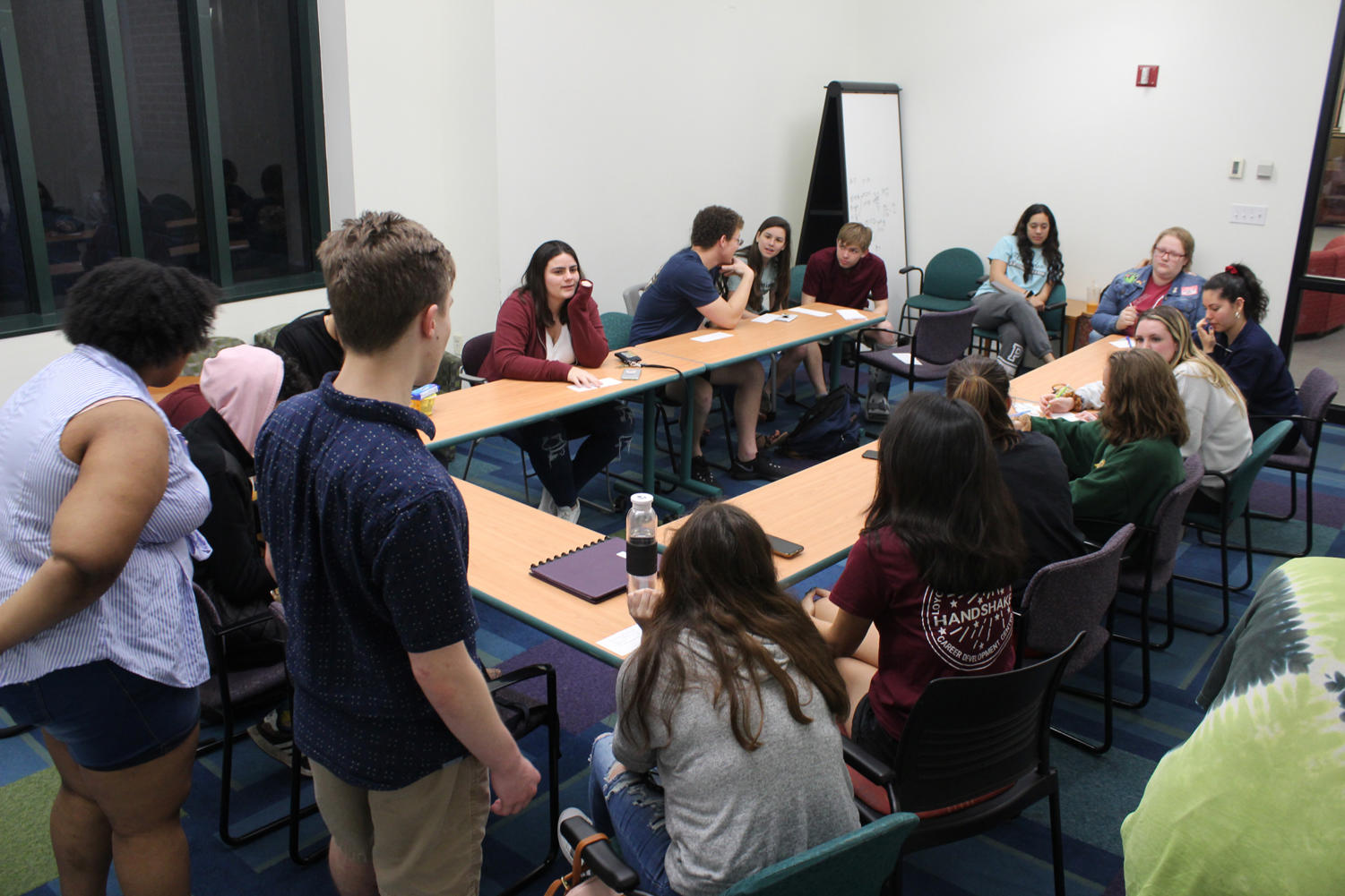 Chandler Boudreaux, finance freshman, and Shamaria Bell, general studies freshman, lead the first meeting of the Photography Organization for Wolves on March 13, 2019. Photo credit: Cristian Orellana