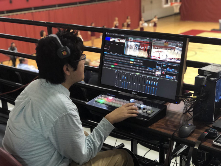 Mass+communication+senior+Yuri+Oguma+operates+the+switcher+in+The+Den+during+a+live+broadcast+of+a+basketball+game.+Photo+credit%3A+Albert+Dupont