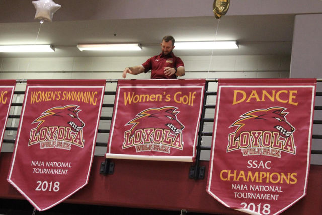 Banners+were+hung+for+the+dance+team%2C+the+women%E2%80%99s+golf+team+and+both+swim+teams+at+Senior+Night+on+Feb.+14+2019+for+competing+nationally+last+year.+The+Directors%E2%80%99+Cup+judges+based+on+a+school%E2%80%99s+national+performance.