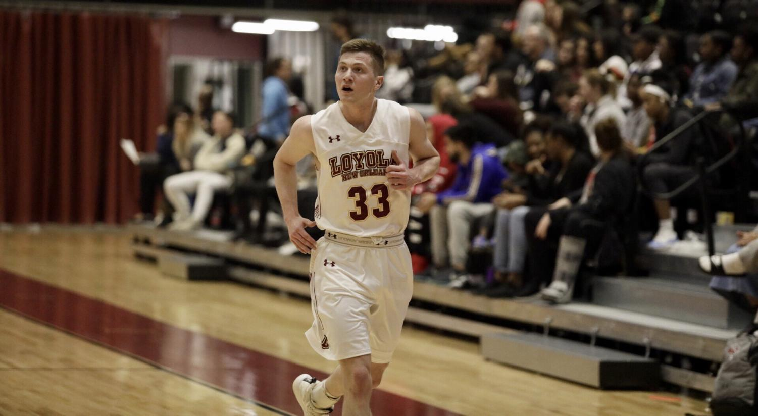 Finance senior Ethan Turner (33) jogs in transition at a Loyola home game in The Den. Turner won three scholar awards this season. Photo credit: Andres Fuentes