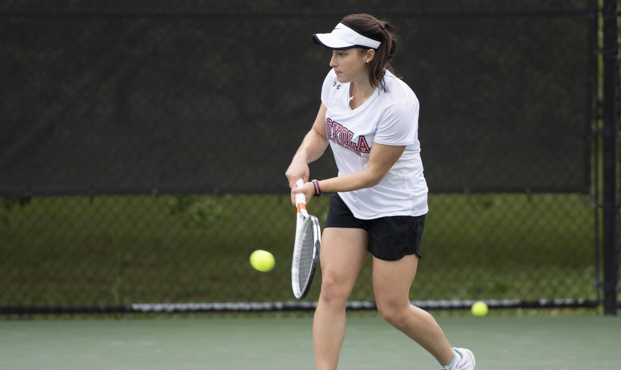Bio-chemistry sophomore Gabrielle Terranova put the Wolf Pack ahead for the win, marking the fourth victory this season over a ranked opponent. The men's team went scoreless in their match versus Mobile. Photo credit: Kyle Encar