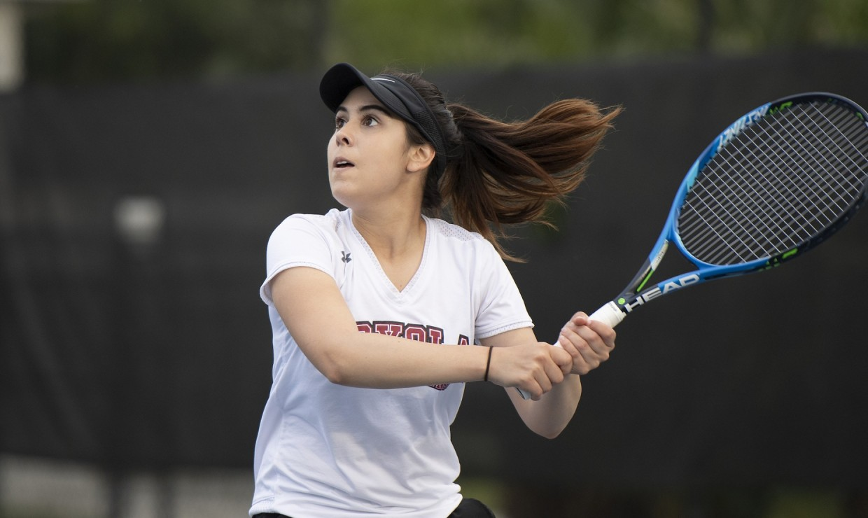 Finance junior Arianna Pepper went 1-6, 6-1, 6-4 in her solo victory in the conference semifinals. Both Loyola teams lost to Middle Georgia in the second round. Photo credit: Kyle Encar