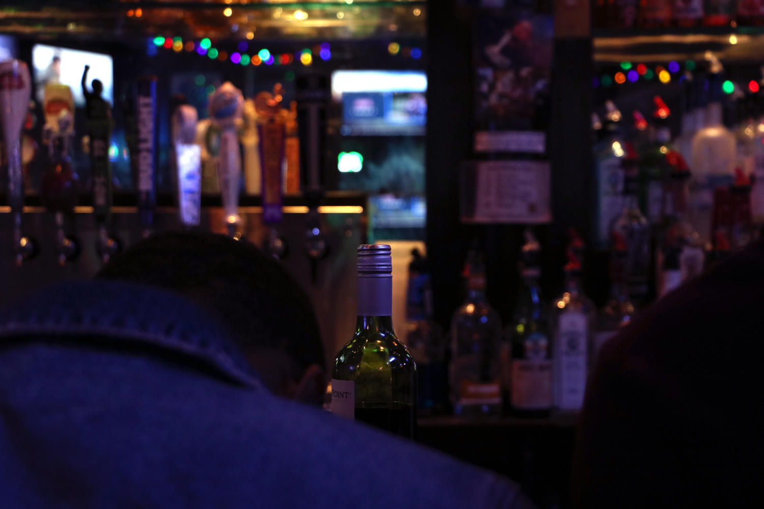 A patron sits at a college bar. Many college bars have a series of health code violations. Photo credit: Hannah Renton