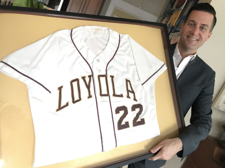 Fletcher+Mackel+poses+with+his+framed+Loyola+jersey.+He+decided+to+frame+his+jersey+after+losing+college+memories+during+Hurricane+Katrina.+Courtesy+of+Fletcher+Mackel.