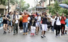 Local musicians second-line for Eugene Grant