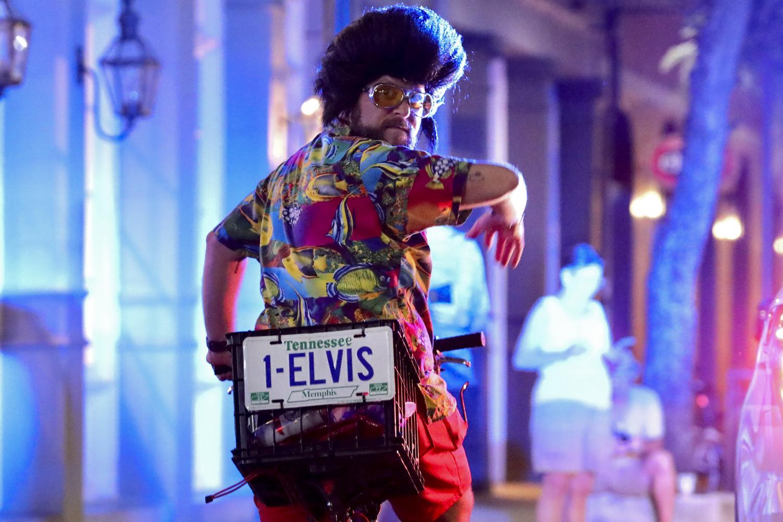 Doug Marshall signals the Krewe of the Rolling Elvi to start their parade near Kerry's Irish Pub on Decatur Street on Aug. 16, 2019.