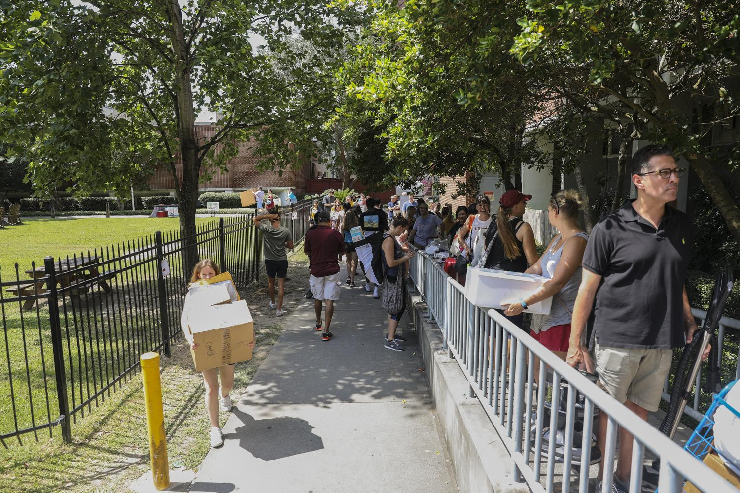 Students move into Buddig hall during move in. Buddig hall is one of two residential halls without live-in community directors.