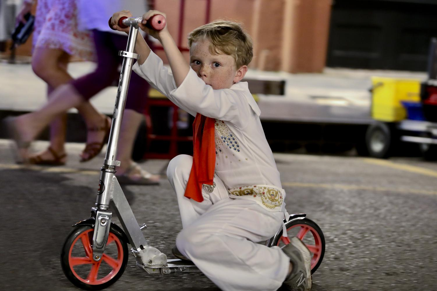 Henry+Lacker%2C+dressed+as+Elvis+Presley%2C+leads+the+Krewe+of+the+Rolling+Elvi+through+the+French+Quarter.