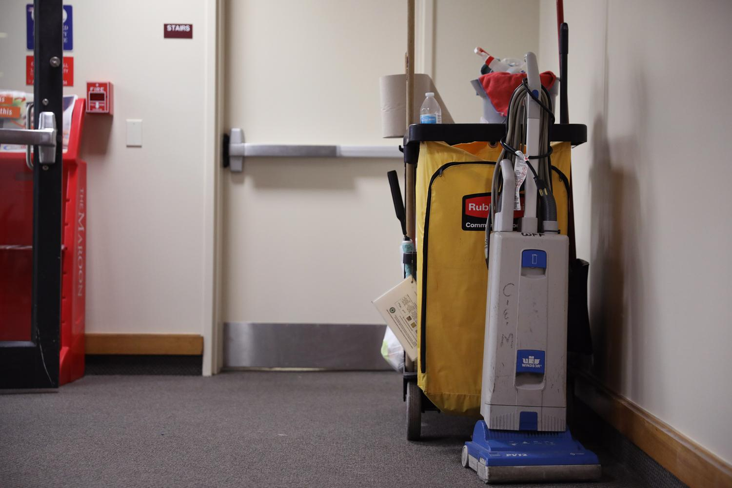 A cleaning cart left by a WFF janitorial worker sits in a hallway on Aug. 21, 2019.  Loyola WFF workers had their hours changed to overnight and early morning shifts for the current school year.