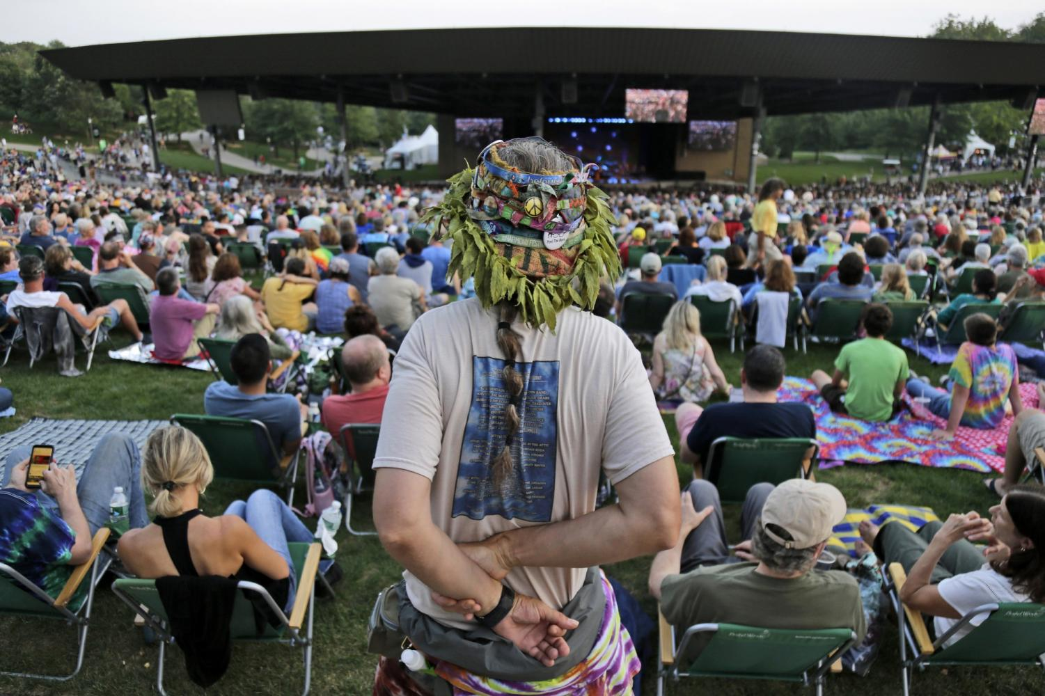Music fans listen to the band Blood, Sweat and Tears play at a concert celebrating the 50th anniversary of Woodstock in Bethel, N.Y., Friday, Aug. 16, 2019. Bethel Woods Center for the Arts is hosting a series of events Thursday through Sunday at the bucolic 1969 concert site, 80 miles (130 kilometers) northwest of New York City.