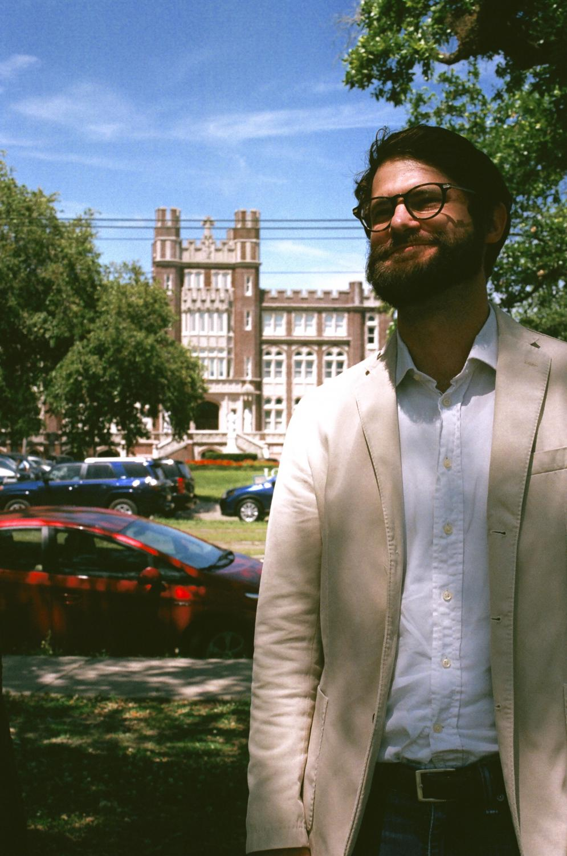 Philosophy professor Everett Fulmer poses for a photo in front of Loyola University. Photo credit: Sofia Santoro